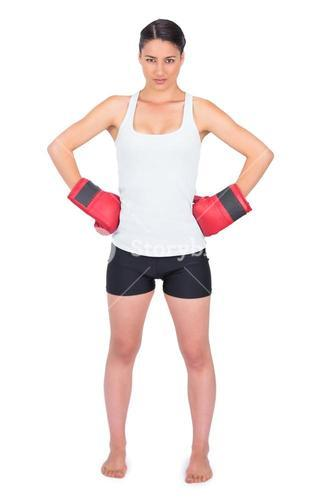 Competitive young model with boxing gloves posing