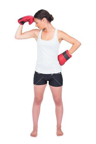 Healthy model with boxing gloves posing