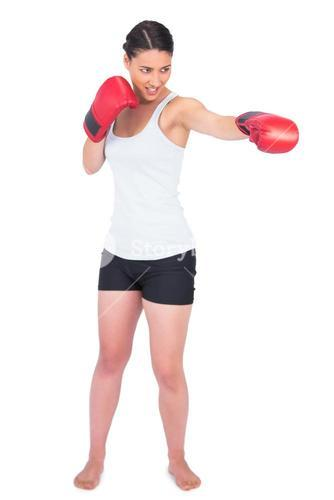Smiling slender model with boxing gloves punching