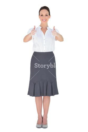 Cheerful businesswoman posing thumbs up