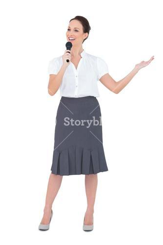 Cheerful presenter holding microphone