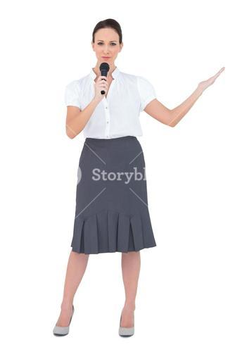 Peaceful presenter holding microphone
