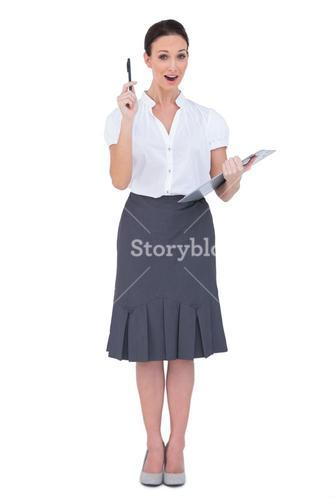 Surprised businesswoman holding clipboard