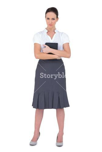 Frowning businesswoman holding notebook