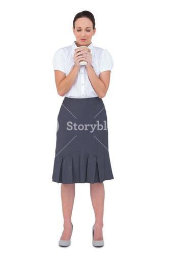 Relaxed businesswoman smelling coffee