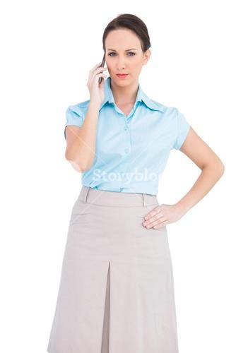 Classy young businesswoman on the phone