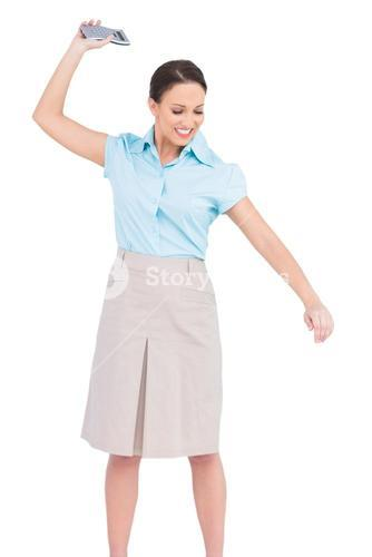 Angry classy businesswoman throwing her calculator
