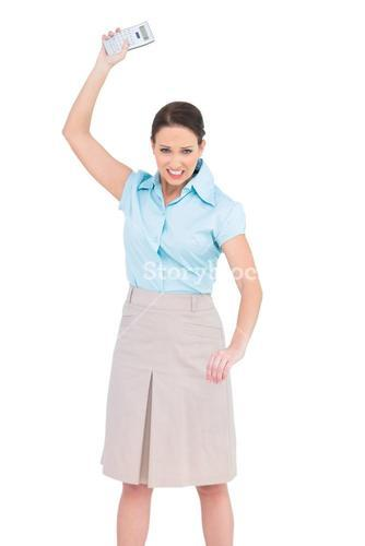 Furious classy businesswoman throwing her calculator