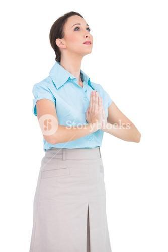 Worried young businesswoman praying