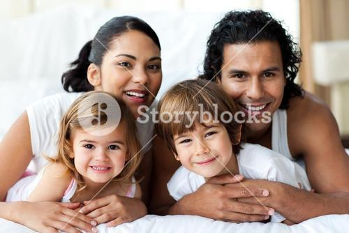Happy family smiling at the camera