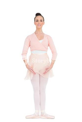 Cheerful gorgeous ballerina standing in a pose