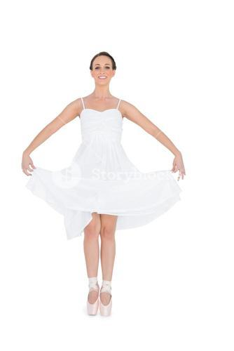 Cheerful young ballet dancer isolated