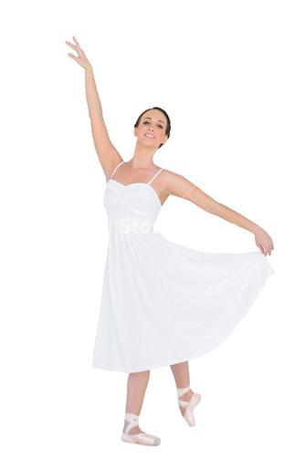 Smiling young ballet dancer posing with her leg back
