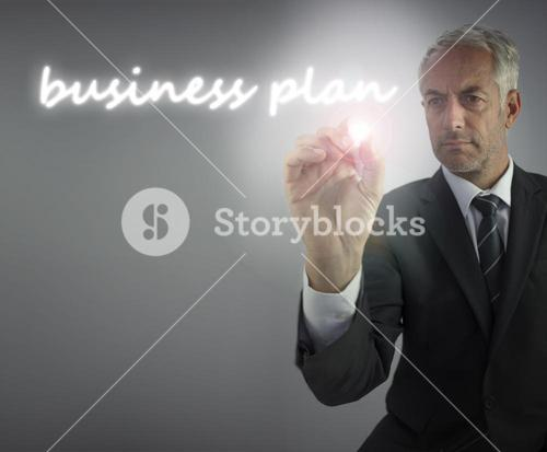 Serious businessman writing business plan