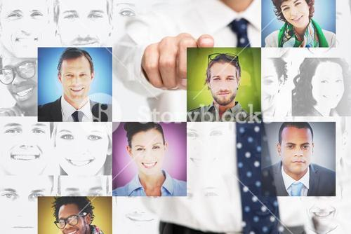 Businessman pointing at digital interface presenting profile pictures