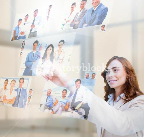 Pleased businesswoman selecting pictures