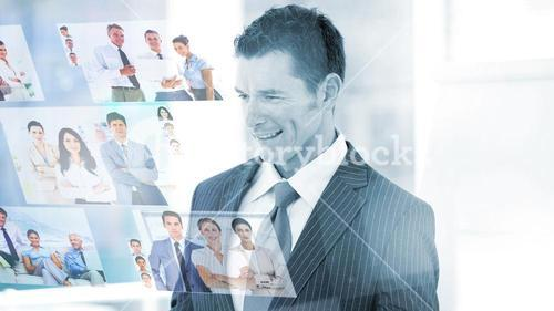 Pleased businessman looking at pictures
