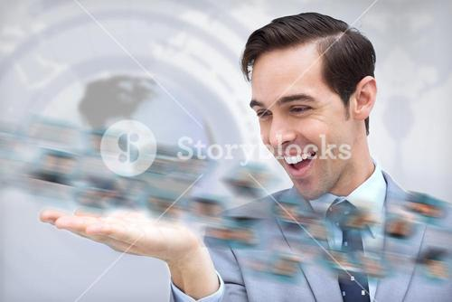 Pleased businessman looking at a picture whirl