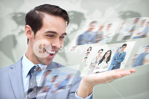 Content businessman looking at pictures