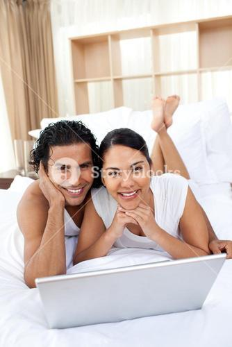 Young couple using a laptop