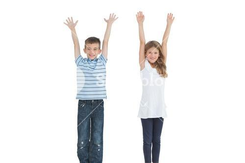 Happy young brother and sister cheering