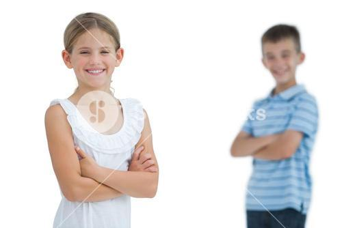 Smiling young girl posing with her brother
