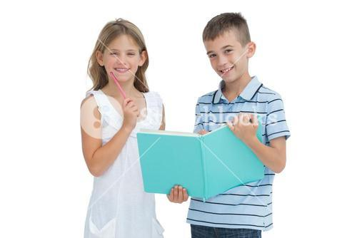 Cheerful brother and sister learning their lesson together