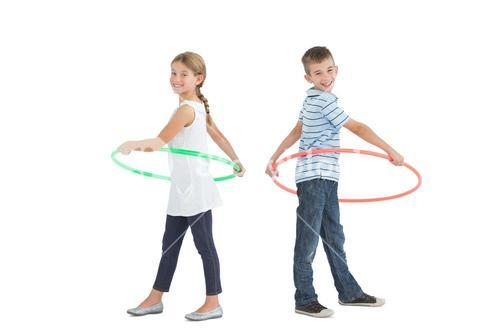 Brother and sister playing with hula hoop