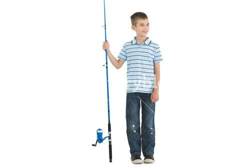 Pensive young boy holding fishing rod