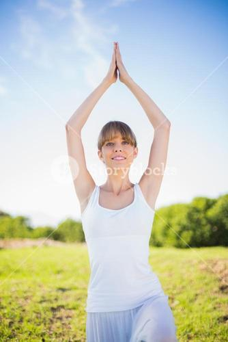 Cheerful young woman exercising outside