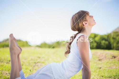 Natural young woman stretching