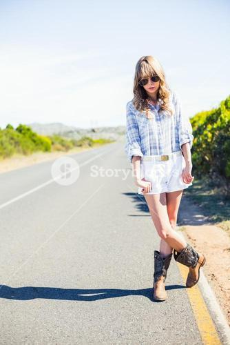 Trendy attractive blonde at the roadside