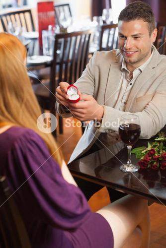 Handsome man making marriage proposal