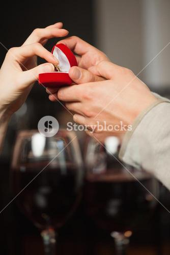 Close up on woman taking the ring during marriage proposal