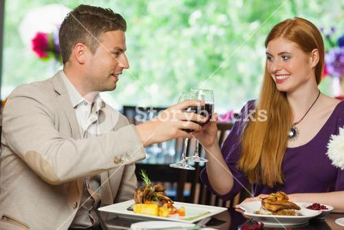 Cheerful couple having dinner together