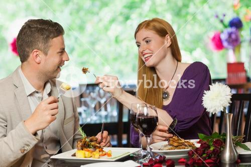 Happy couple eating together