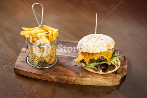 Close up on a cheese burger and french fries