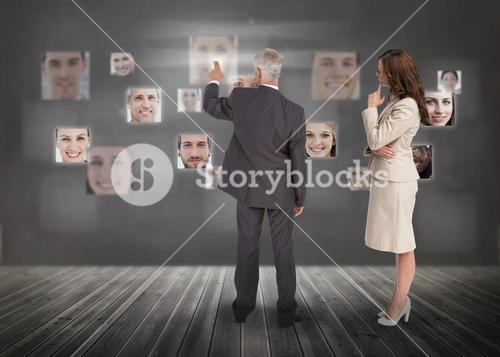 Business people selecting digital interface