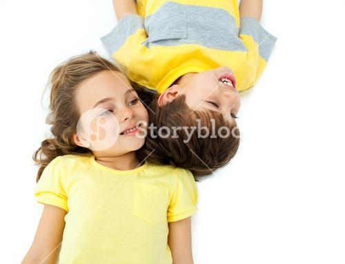 Cute children lying on the floor