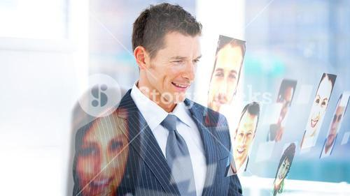 Handsome businessman looking at profile pictures