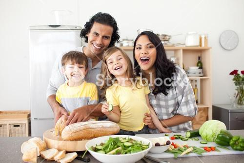 Lively family having fun in the kitchen
