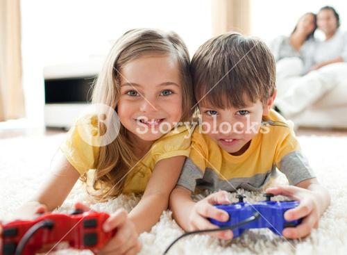 Adorable siblings playing video game