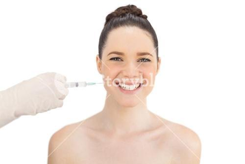 Cheerful natural model having injection around the mouth