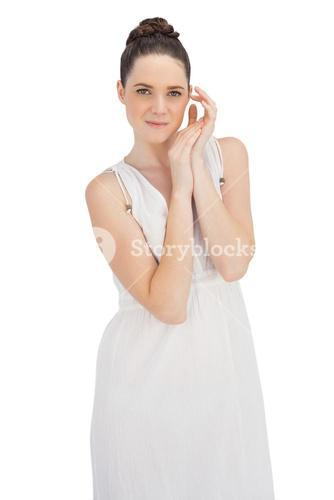 Natural young model in white dress posing