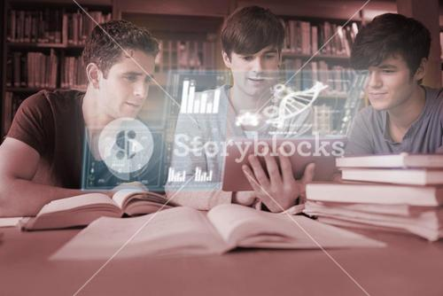 Focused young men studying medicine together with futuristic interface