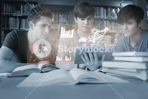Serious young men studying medicine together with futuristic interface