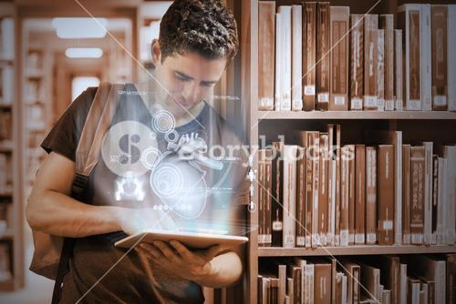 Handsome college student working on his digital tablet pc with futuristic interface