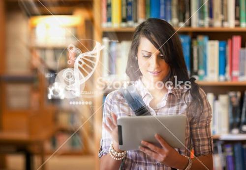 Pretty student using futuristic interface to learn about science from digital tablet