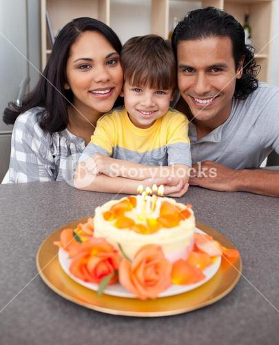 Attentive parents celebrating their sons birthday in the kitchen