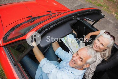High angle view of cheerful mature man having a ride with his wife